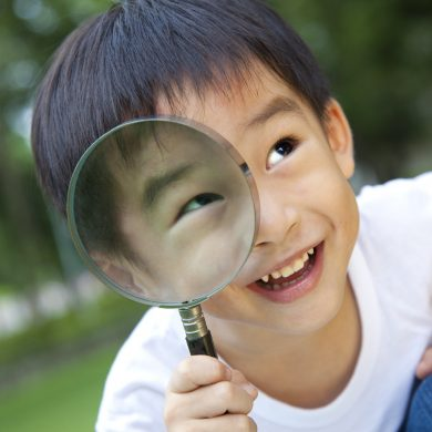 10776750 - asian boy holding magnifier