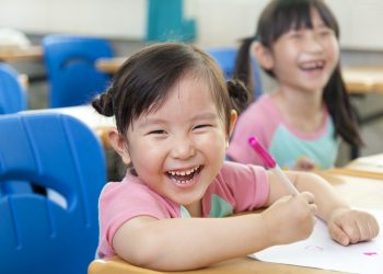 13550130 - happy little girls in the classroom