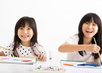 happy children painting in the classroom